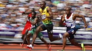 Usain Bolt of Jamaica runs on his way to winning his 100m heat round 1 during the London 2012 Olympic Games at the Olympic Stadium